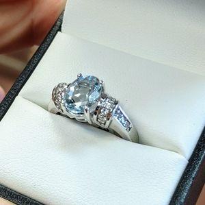 14k light blue topaz and diamond ring